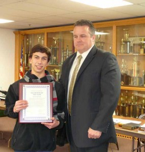 Nick Raefski accepts Youth Volunteer Award for 2013 from Mayor Mark Desire/