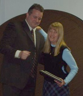 """Mayor Mark Desire presents the """"Recognition of Service"""" award to departing Councilwoman Lynn Hughes."""