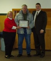 Rich Carr receiving the 2008 Longevity of Service award presented by Councilwoman Murdock and Mayor Desire