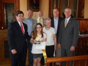Ellie Curtin with the five Hunterdon County Freeholders and Stephanie Stevens, Chair of the County Cultural and Heritage Committee receiving her award in May at the Freeholders' Meeting. The County Cultural and Heritage Committee sponsors the historic essay contest annually.