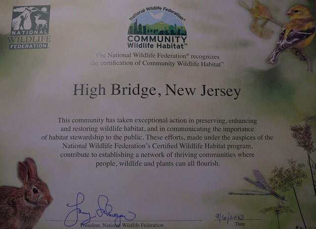 color photo of signed wildlife habitat certificate