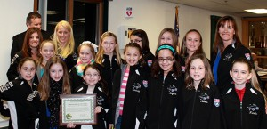 "AYC National Champion  Hunterdon Huskies JPW cheerleading squad at the High Bridge Borough Council Meeting where they were named ""Ambassadors of High Bridge."""