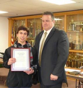 Nick Raefski accepts Youth Volunteer Award for 2013 from Mayor Mark Desire/