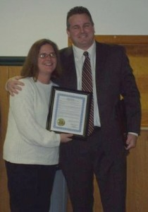"""Mayor Desire presents the """"Recognition of Service"""" award to departing Councilwoman Colleen Hann"""